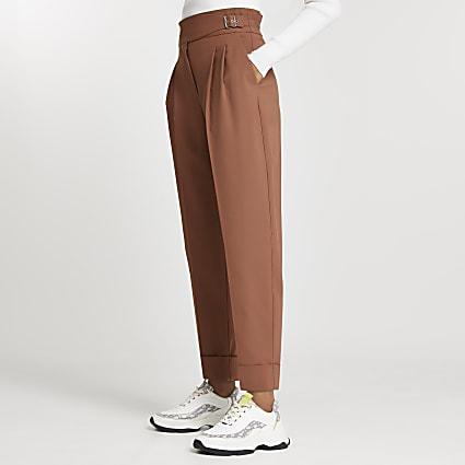 Petite beige buckle waist peg trousers