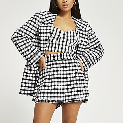Petite black check print shorts