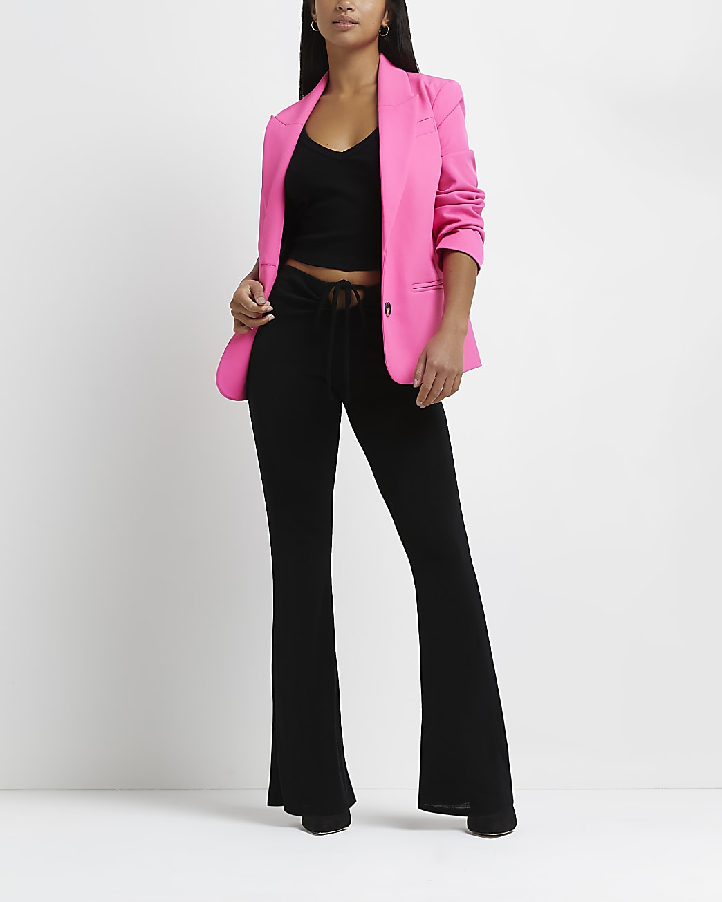 Petite black cut out flared trousers