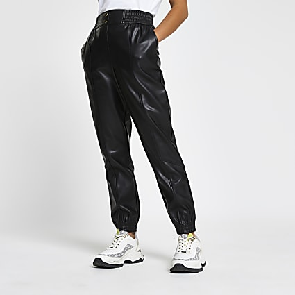 Petite black faux leather slim leg joggers