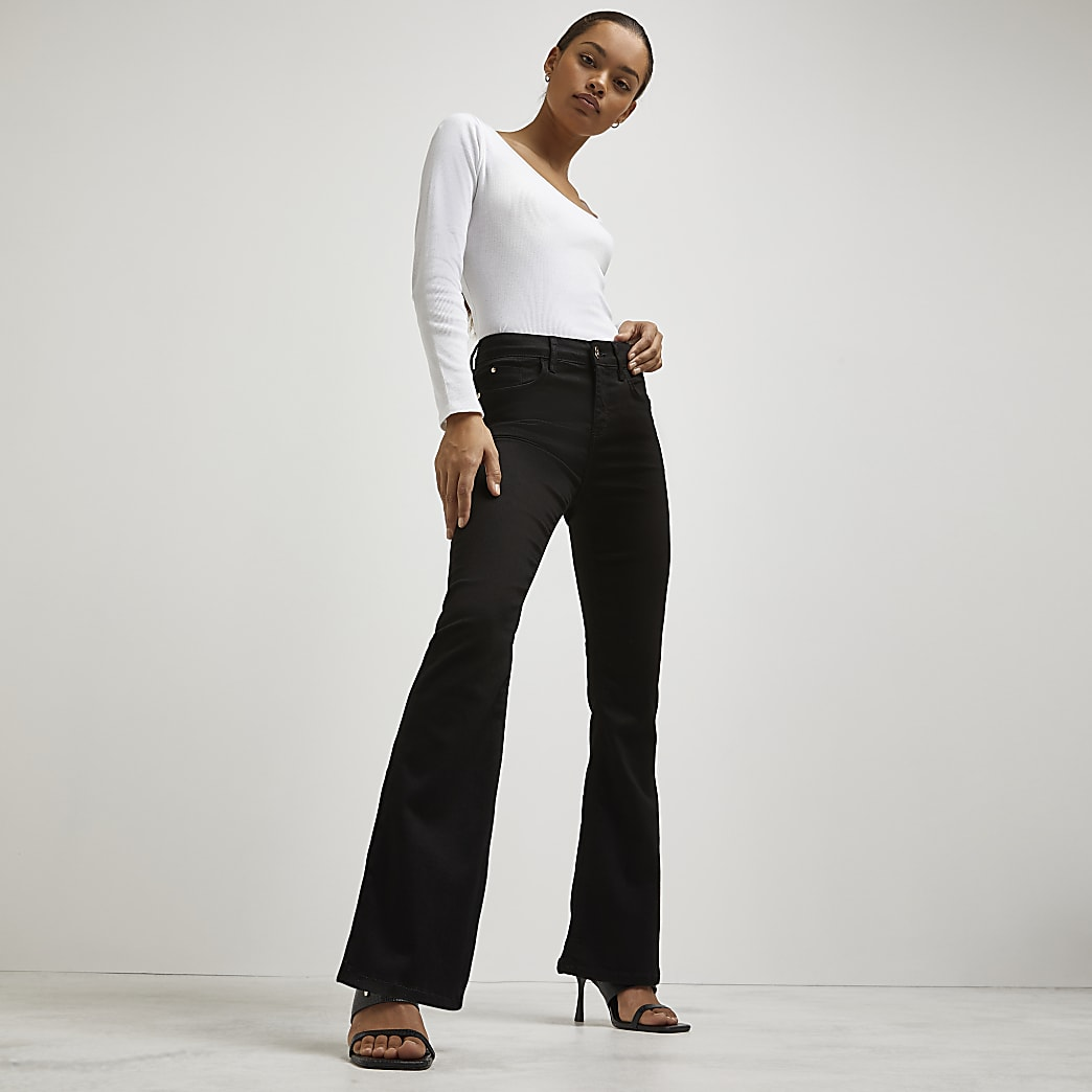 Petite black mid rise flare jeans
