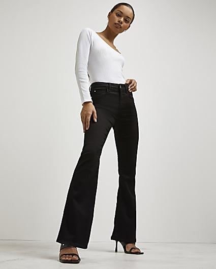 Petite black mid rise flared jeans