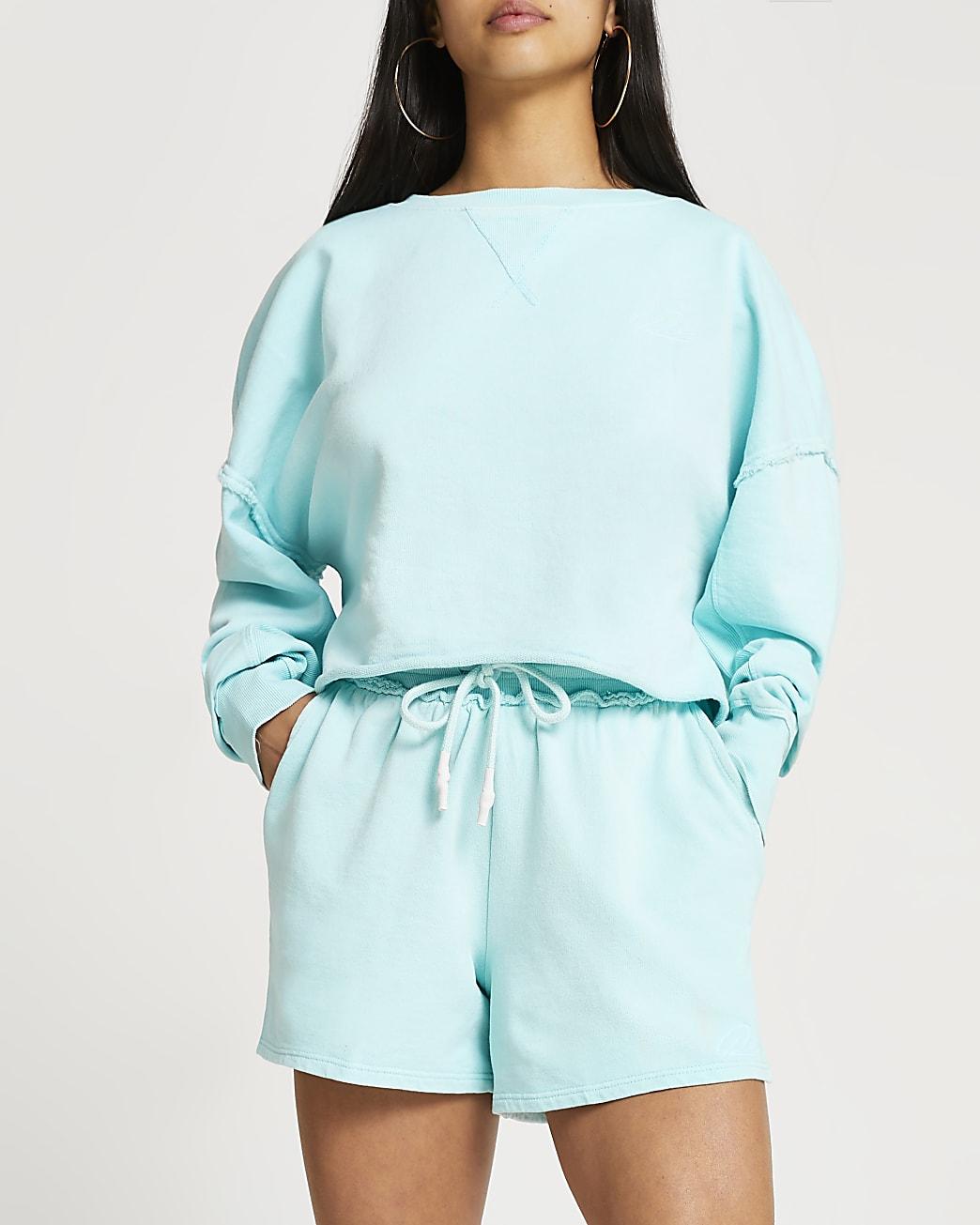 Petite blue exposed seam sweatshirt