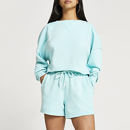 Petite blue exposed seam sweatshirt