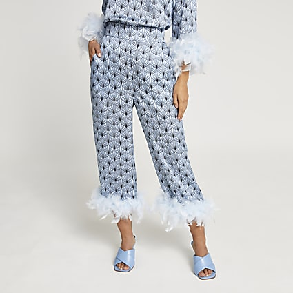 Petite blue geometric feather hem trousers