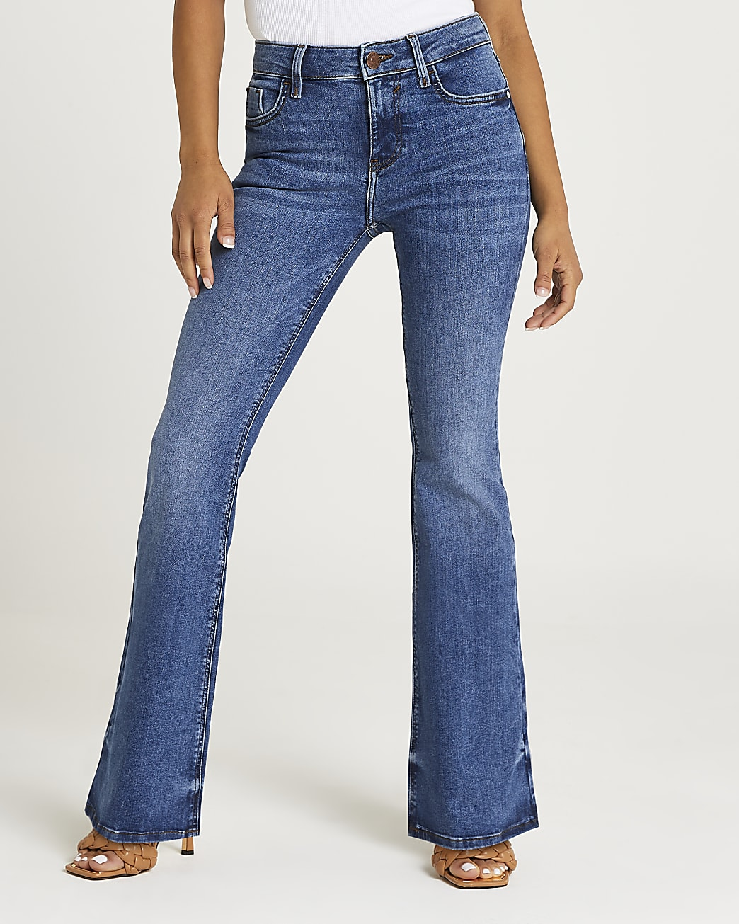 Petite blue mid rise flared jeans