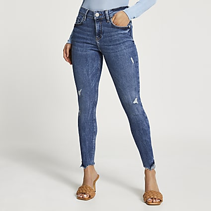 Petite Blue Ripped Mid Rise Skinny Jean