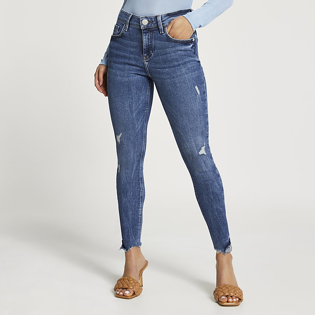 Petite Blue Ripped Mid Rise Skinny Jean