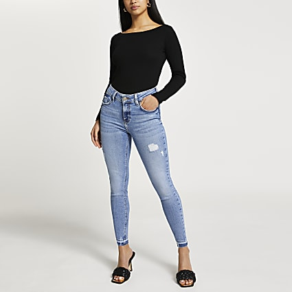 Petite blue ripped mid rise skinny jeans