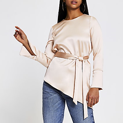 Petite pink long sleeve asymmetric hem top