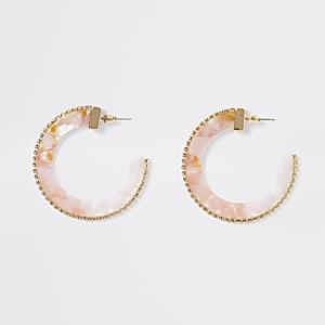 Roze ronde acryl oorbellen met siersteentjes