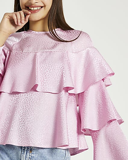 Pink animal print ruffle blouse top