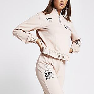 Roze sweater met 'ATLR'-print en halve rits