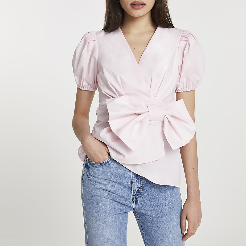 Pink bow front peplum blouse top