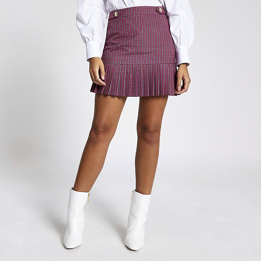Mini-jupe péplum plissée à carreaux rose