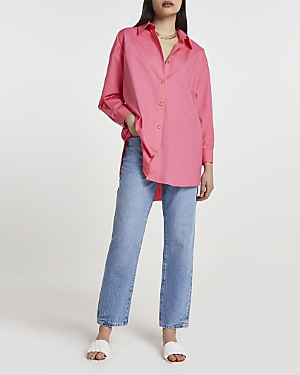 Pink cinched in oversized shirt