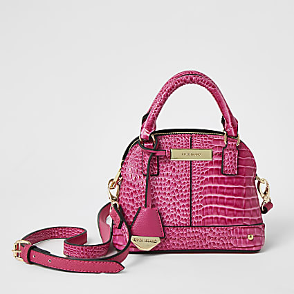 Pink croc embossed cross body kettle bag
