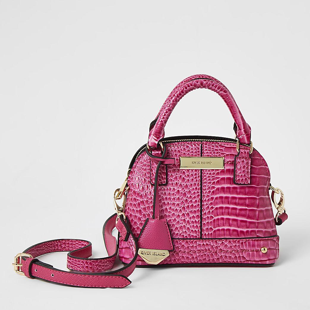 Pink croc embossed cross body kettle bag