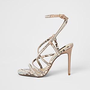Roze sandalen met wijde pasvorm, bandjes met siersteentjes en hoge hak