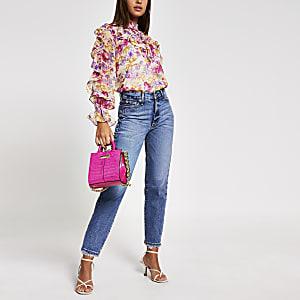 Roze blouse met bloemenprint en lange mouwen met ruches
