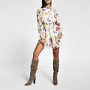 Mini-robe cintréeà manches longues fleurie rose