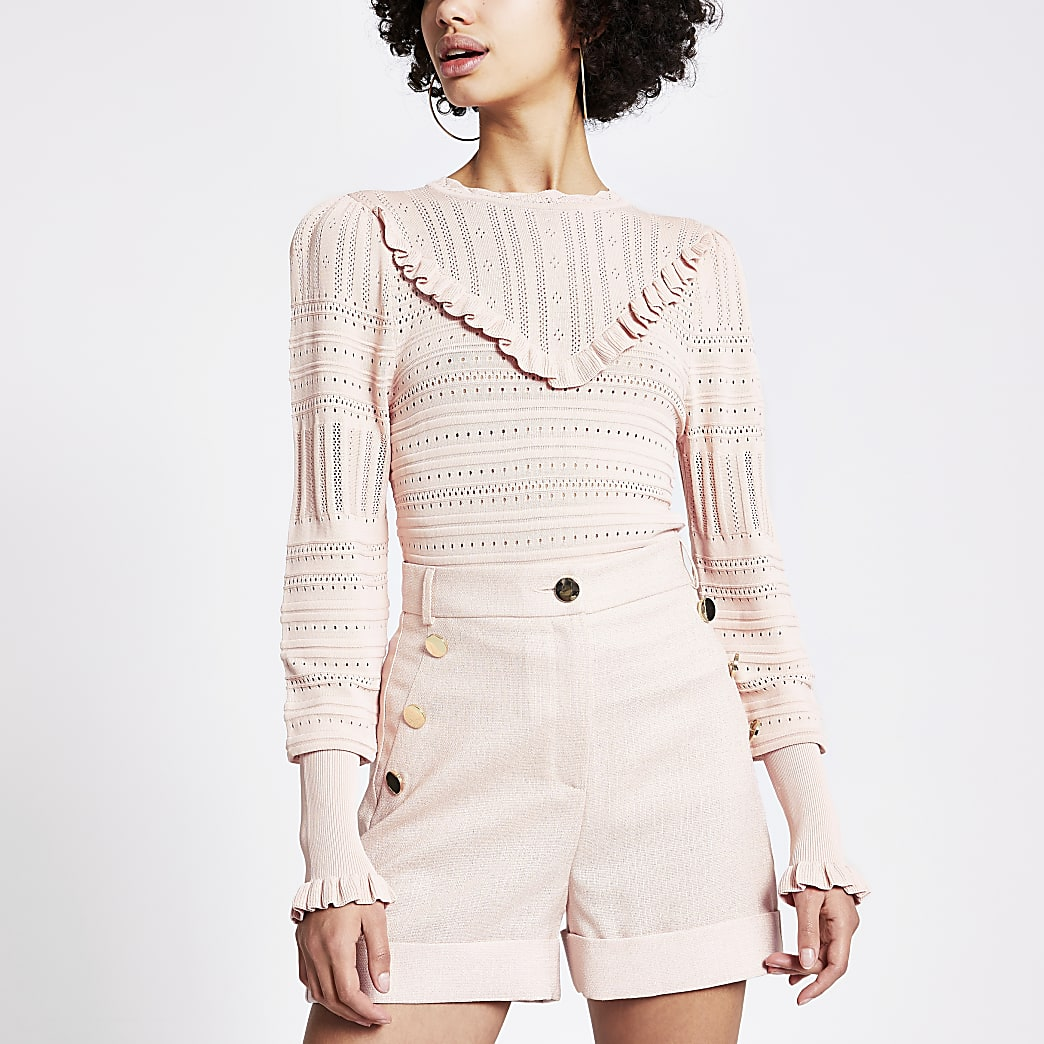 Pull en maille rose à joli points et volants