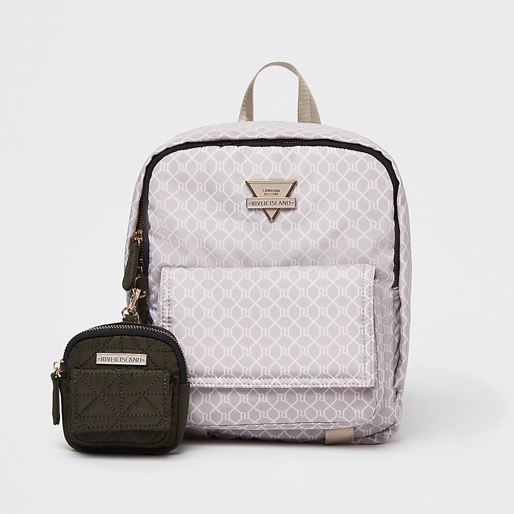 Pink front flap backpack with pouch