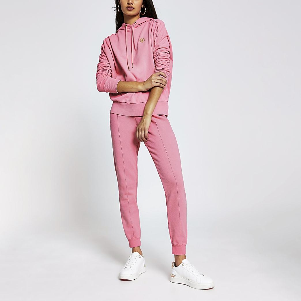 Pink long sleeve exposed seam hoodie