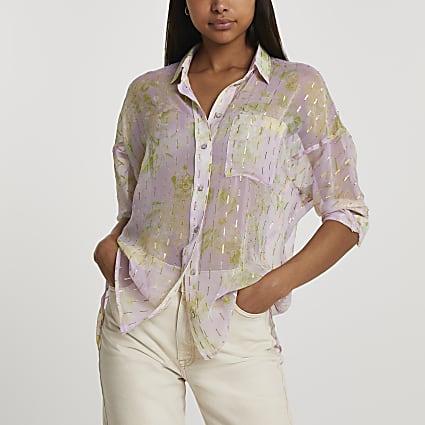 Pink long sleeve floral dipped hem shirt