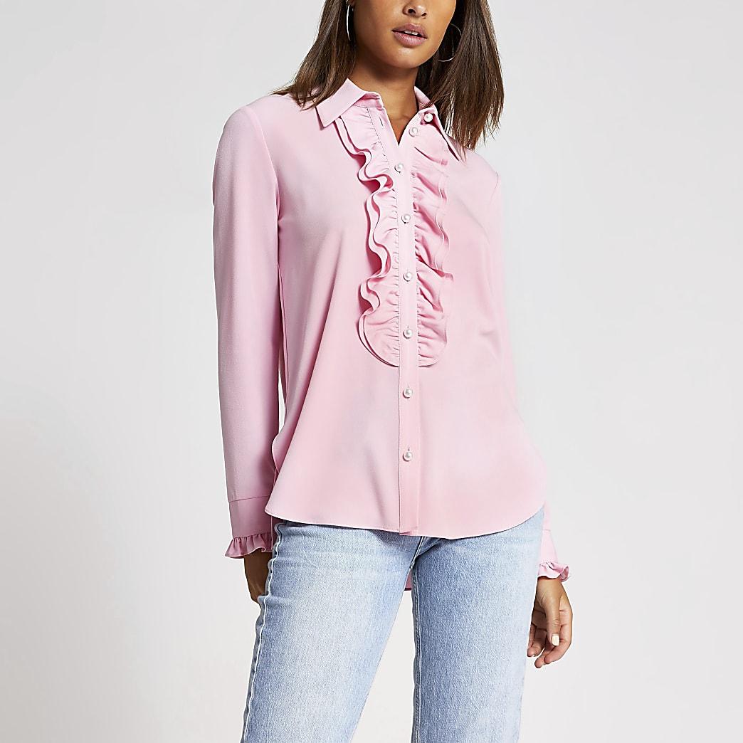 Chemise rose à volants et manches longues