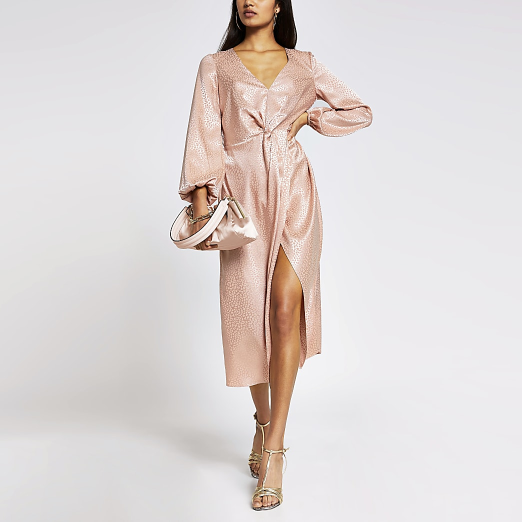 Pink long sleeve twist front midi dress