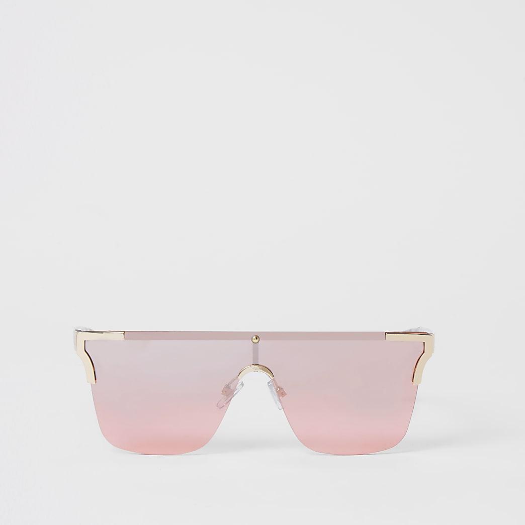Roze visor zonnebril zonder randen en met metalen hoeken