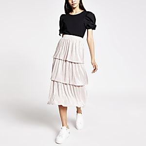 Jupe mi-longue en jersey plisséà volants rose