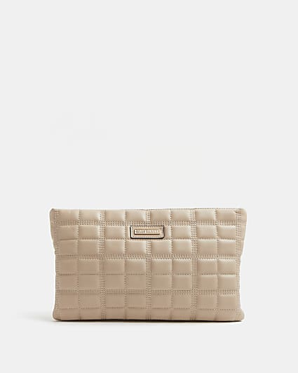 Pink quilted clutch bag