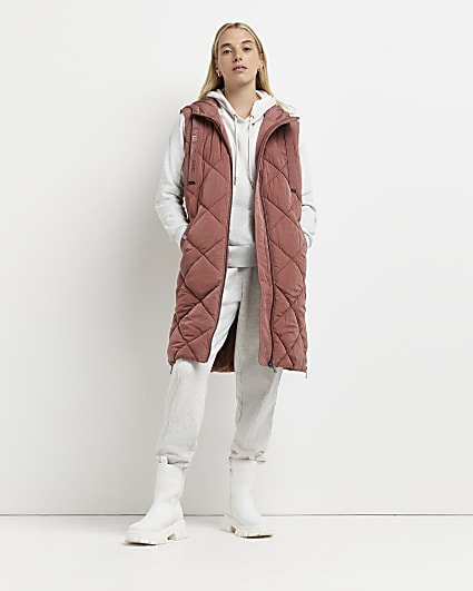 Pink quilted hooded gilet