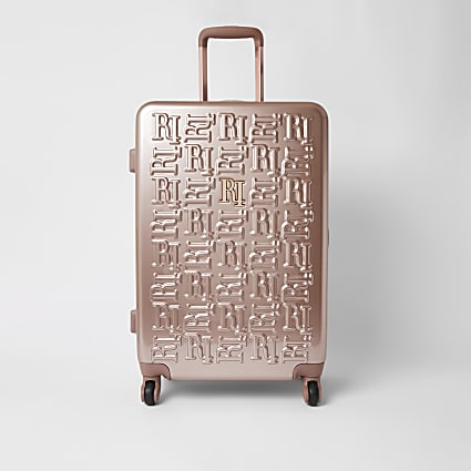 Pink RI embossed hardshell medium suitcase