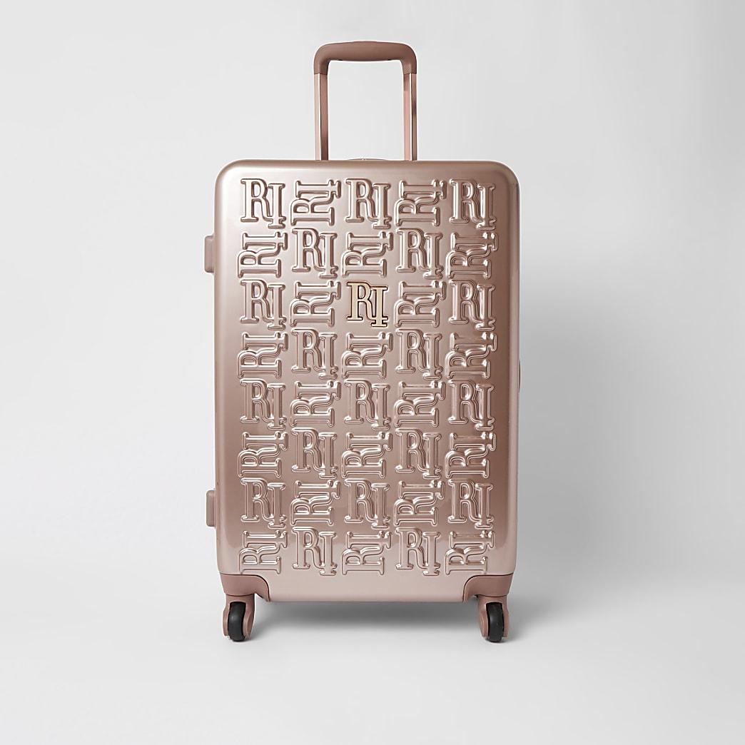 Pink RI embossed hardshell medium suitcase