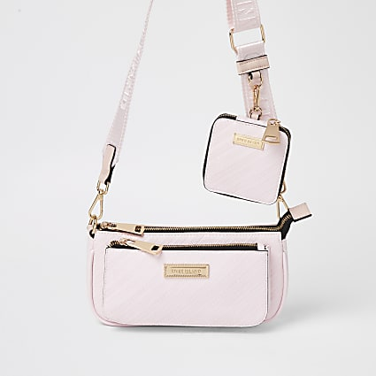 Pink RI embossed pouchette cross body bag