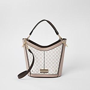 Pinke Bucket-Tasche zum Umhängen mit RI-Monogramm