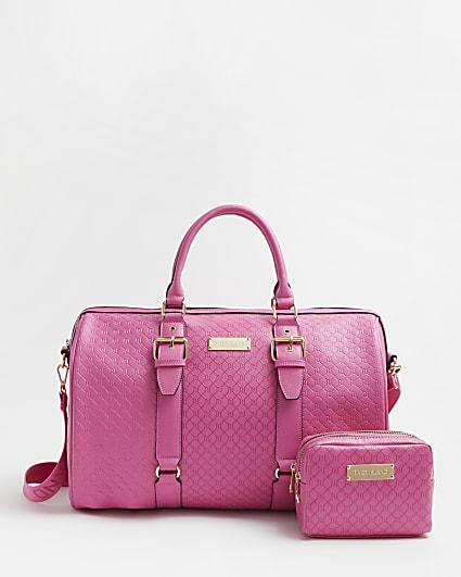 Pink RI monogram embossed barrel bag
