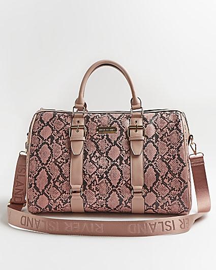 Pink snake print barrel bag