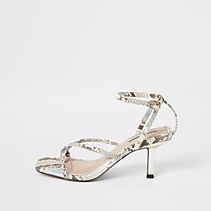 Roze sandalen met bandjes, slangenprint en teenlus
