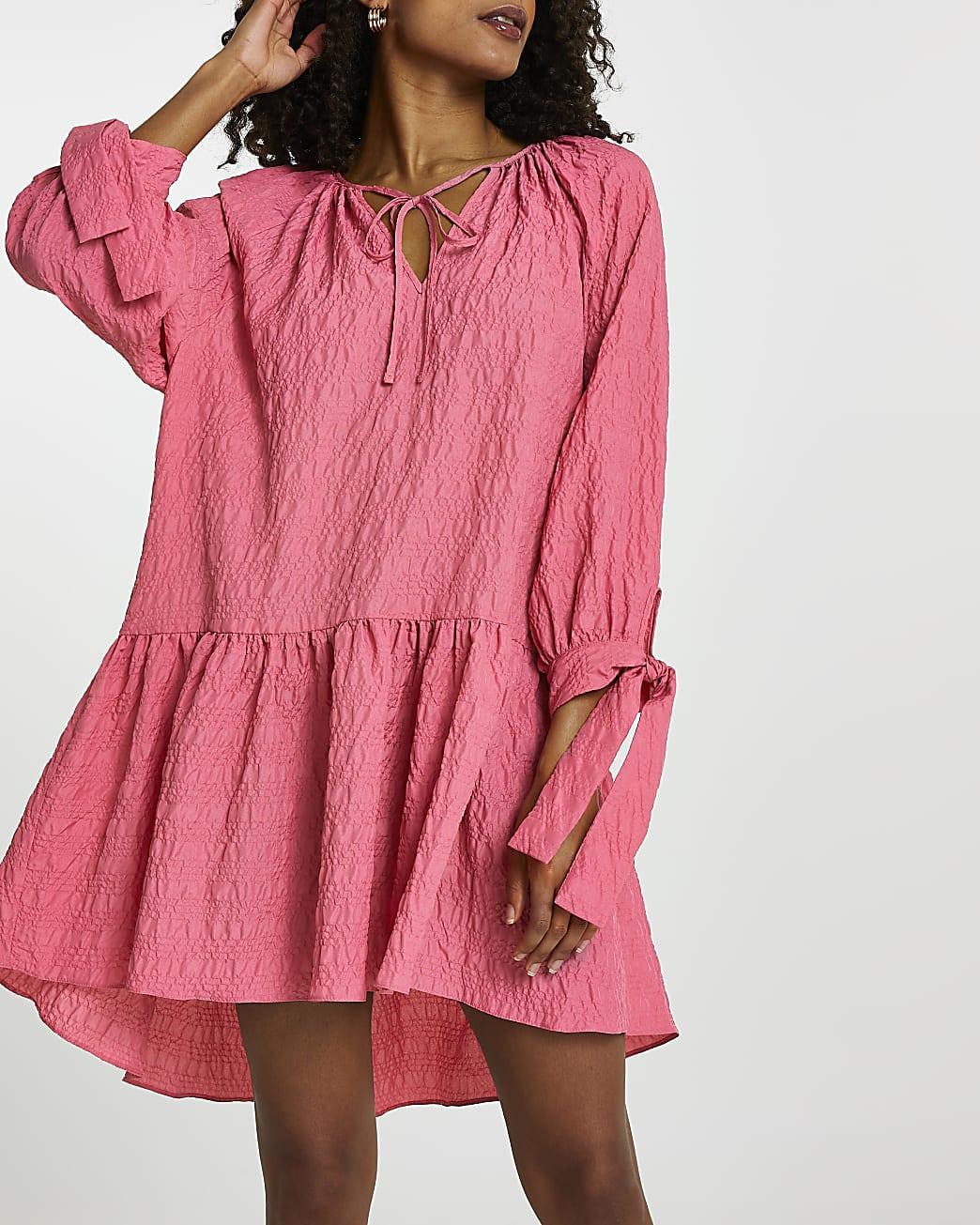 Pink textured tie neck smock dress