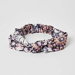 Roze tie-dyehoofdband met knoop en siersteentjes