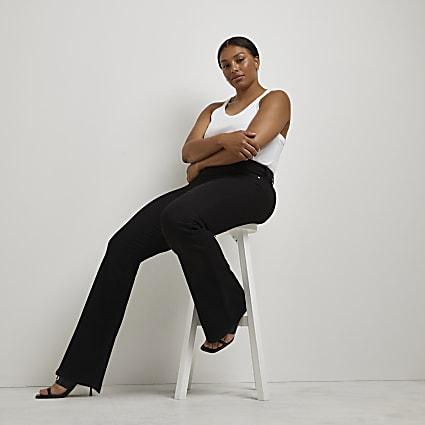 Plus black mid rise flared jeans