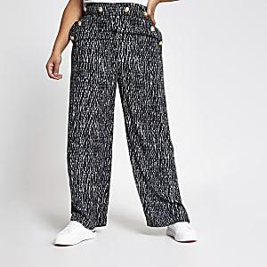 RI Plus - Zwarte broek met print, knopen en wijde pijpen