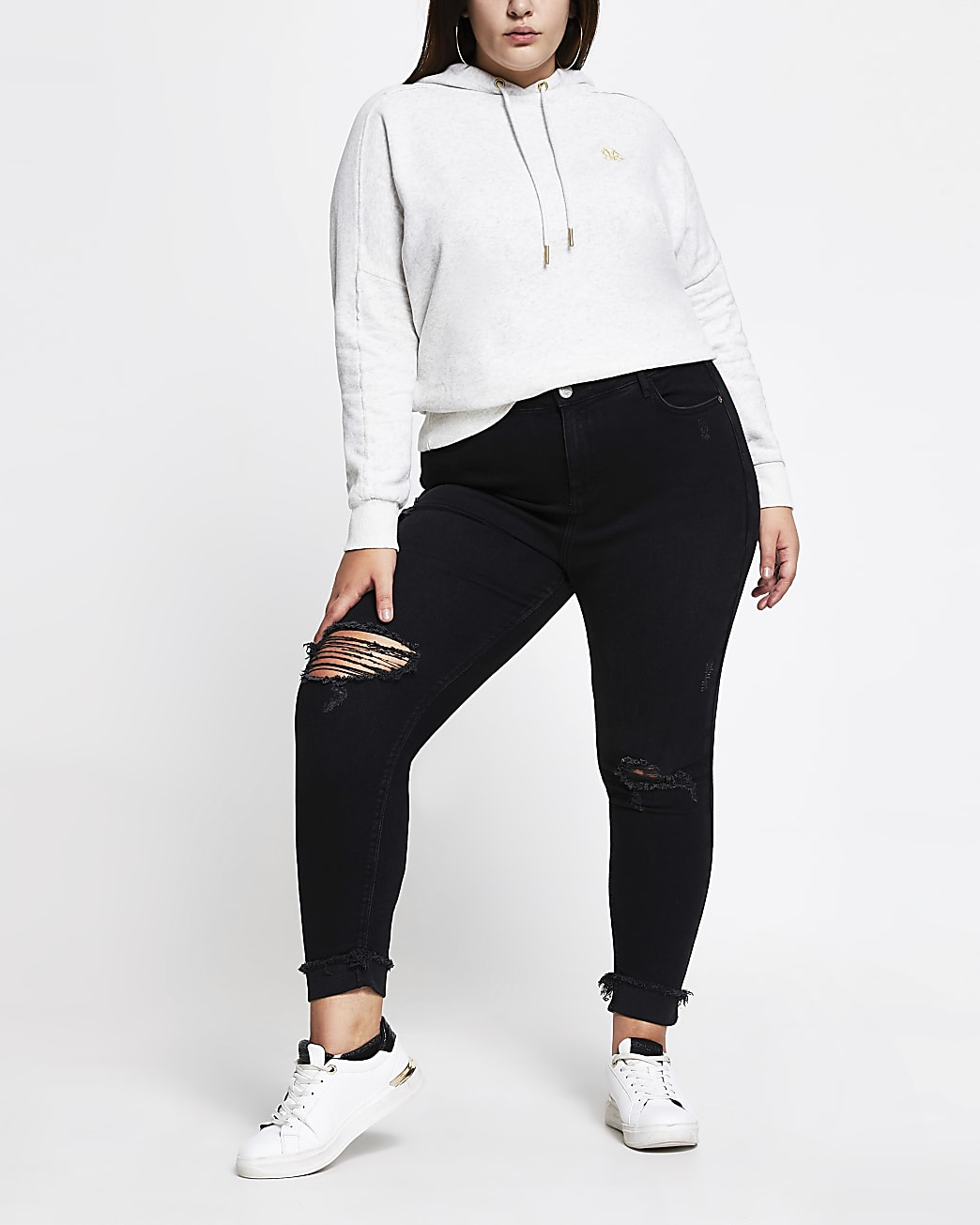 Plus Black ripped mid rise skinny jeans