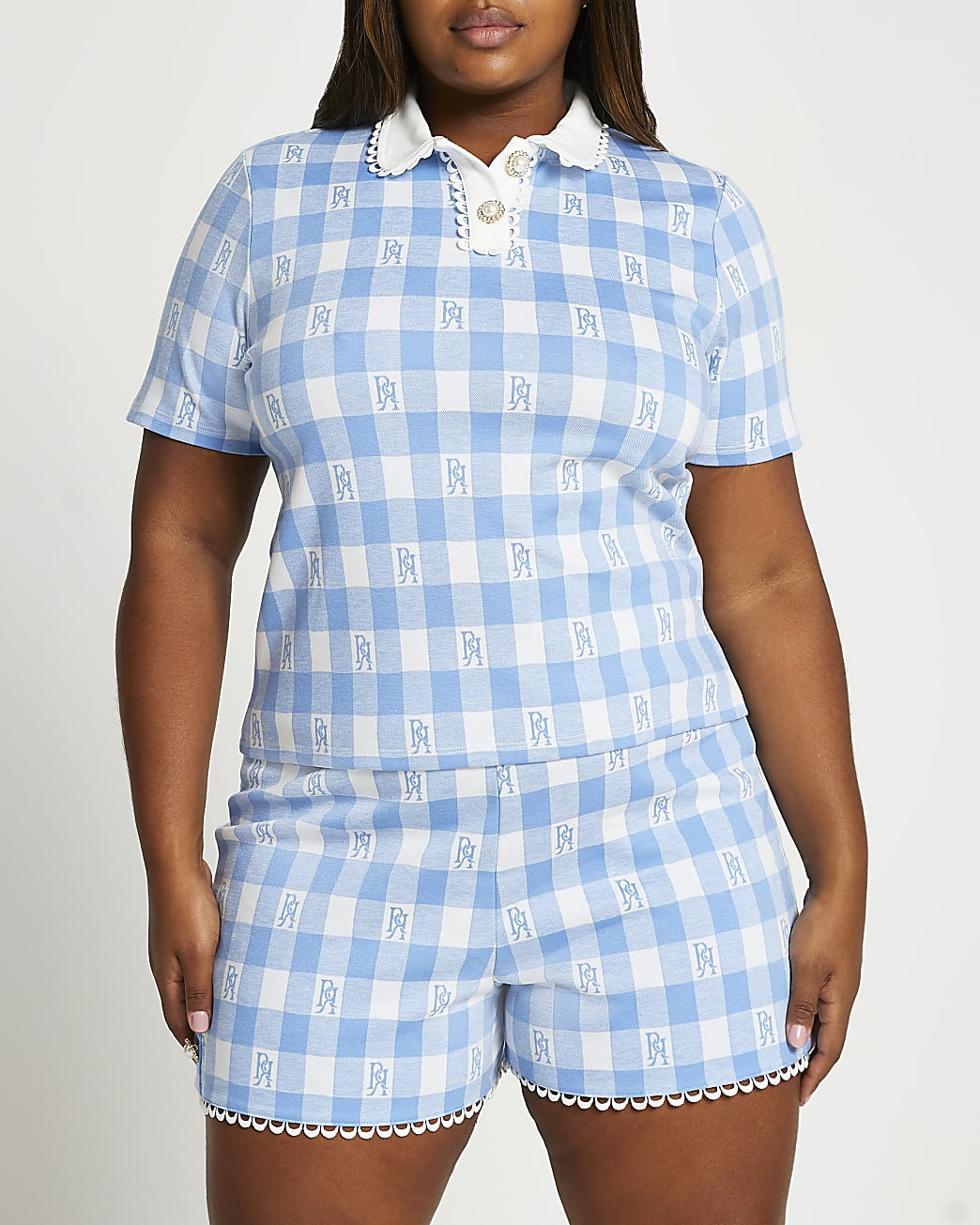 Plus blue short sleeve jacquard polo top