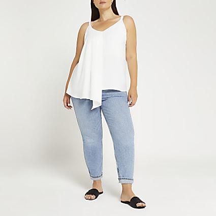 Plus white asymmetric cami top