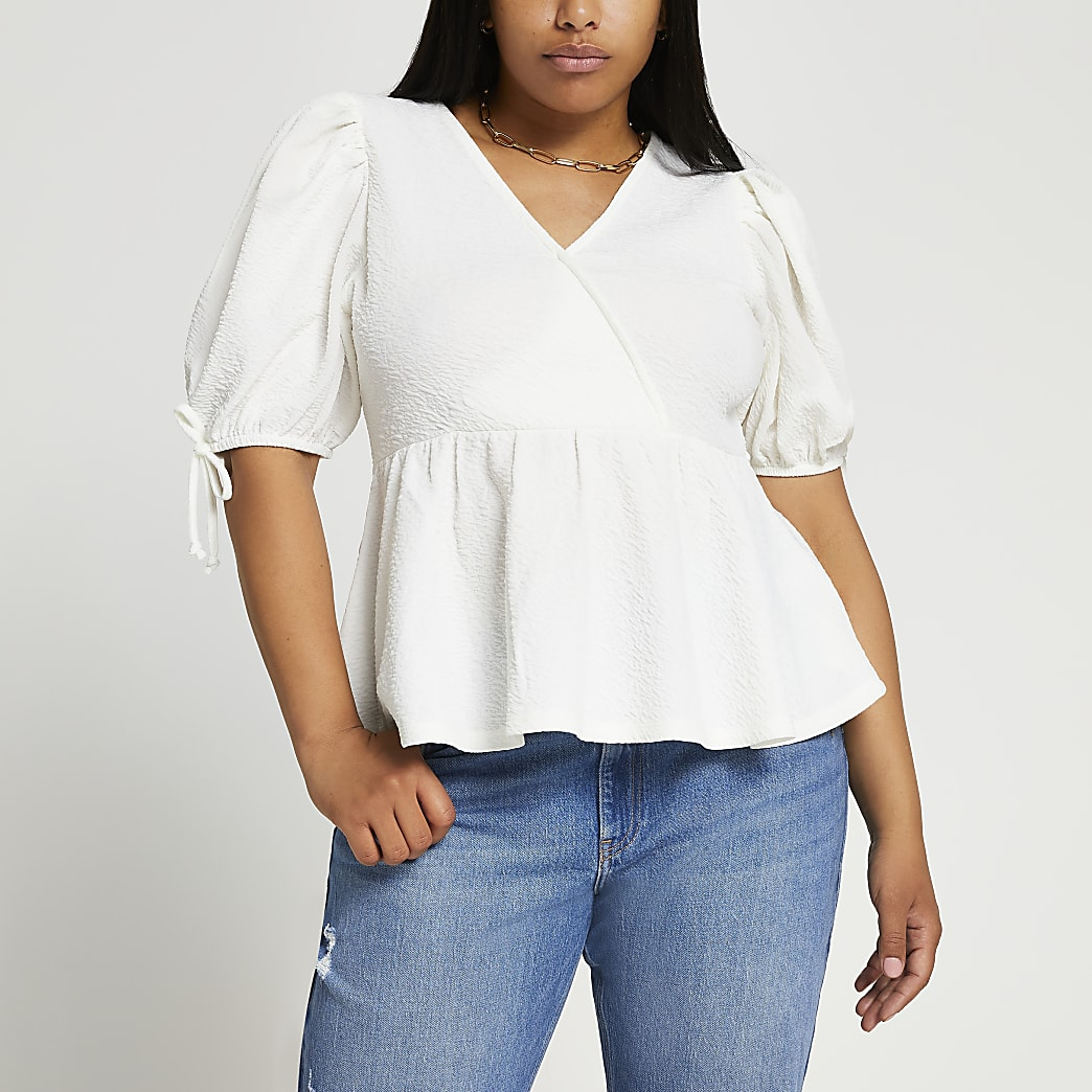 Plus white puff sleeve peplum hem top